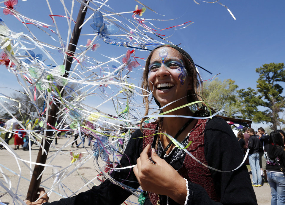 Photo - Annie Llamas, Miami, Florida resident, sells fairy wands during the Medieval Fair at Reaves Park on Friday, April 5, 2013 in Norman, Okla.  Photo by Steve Sisney, The Oklahoman