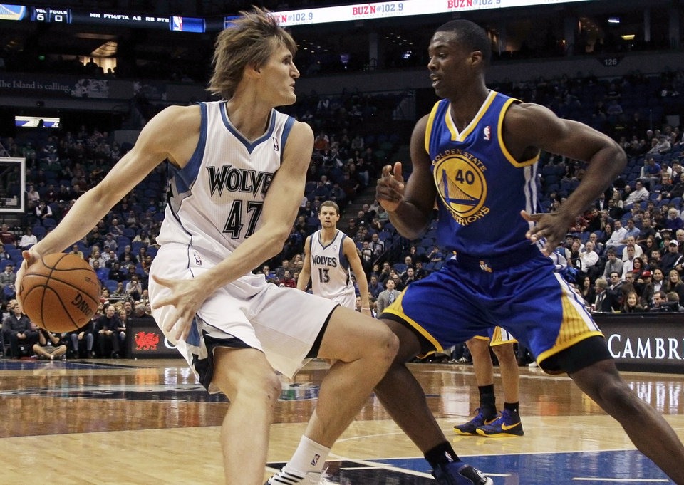 Minnesota Timberwolves' Andrei Kirilenko, left, of Russia, drives around Golden State Warriors' Harrison Barnes in the first half of an NBA basketball game on Friday, Nov. 16, 2012, in Minneapolis. (AP Photo/Jim Mone)