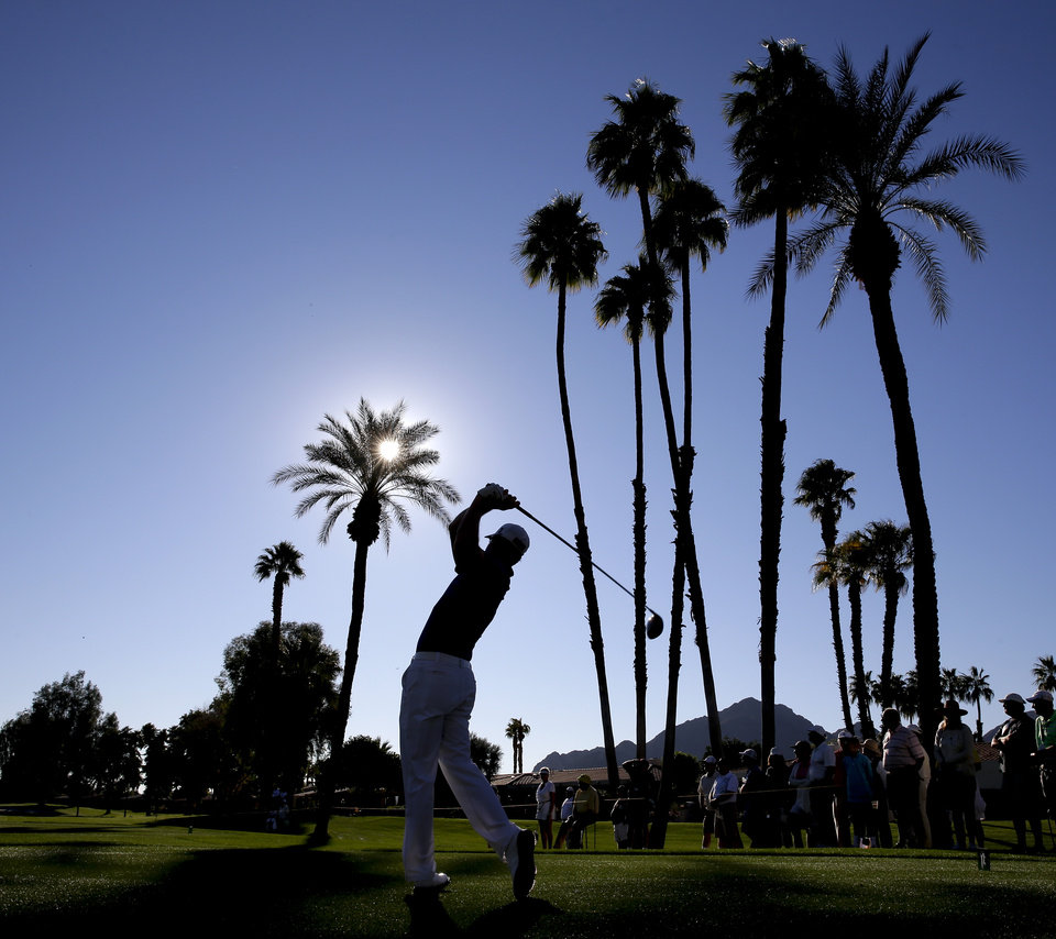 Zach Johnson watches his tee shot on second hole during the first round of the Humana Challenge golf tournament at the La Quinta Country Club on Thursday, Jan. 16, 2014, in La Quinta, Calif. (AP Photo/Chris Carlson)