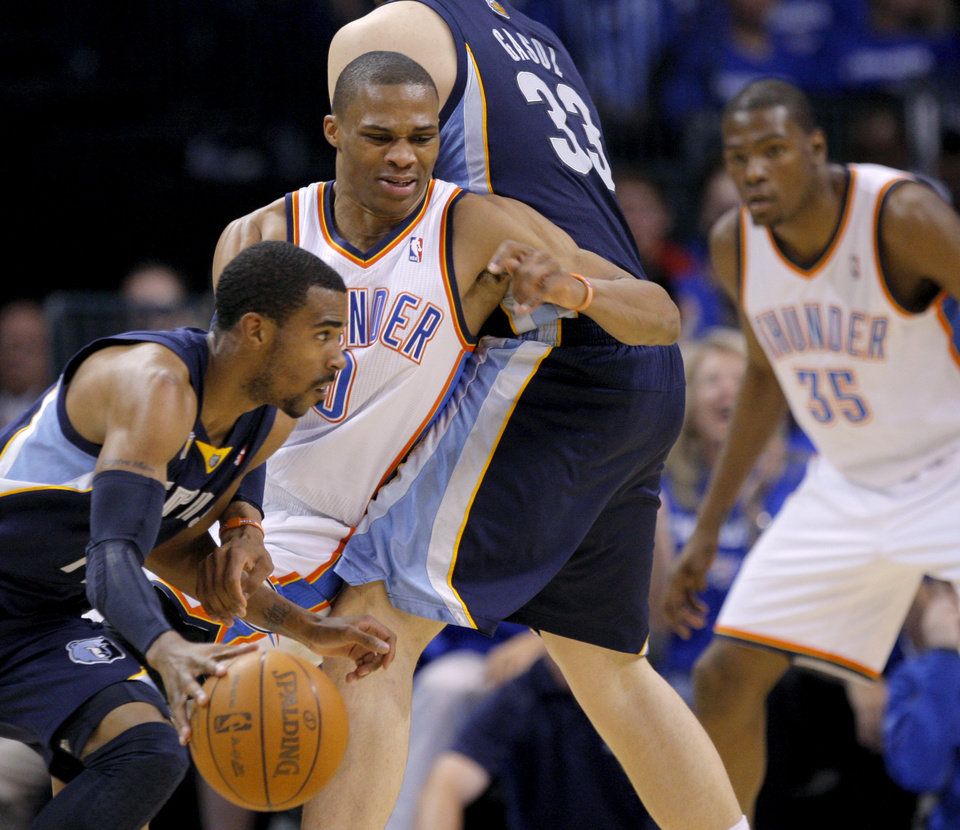 Photo - Oklahoma City's Russell Westbrook (0) defends Mike Conley (11) of Memphis during game two of the Western Conference semifinals between the Memphis Grizzlies and the Oklahoma City Thunder in the NBA basketball playoffs at Oklahoma City Arena in Oklahoma City, Tuesday, May 3, 2011. Photo by Bryan Terry, The Oklahoman
