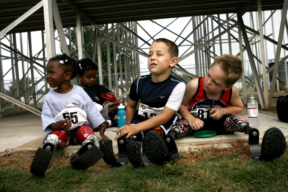 Hannah Hewett, 5, left, Elias Brown, 4, Cameron Lutges, 7, and Cody McCasland, 7, all competitors, scope out the races under the bleachers June 13, 2009 at the Endeavor Games at Edmond North High School.  Photo by Ashley McKee, The Oklahoman