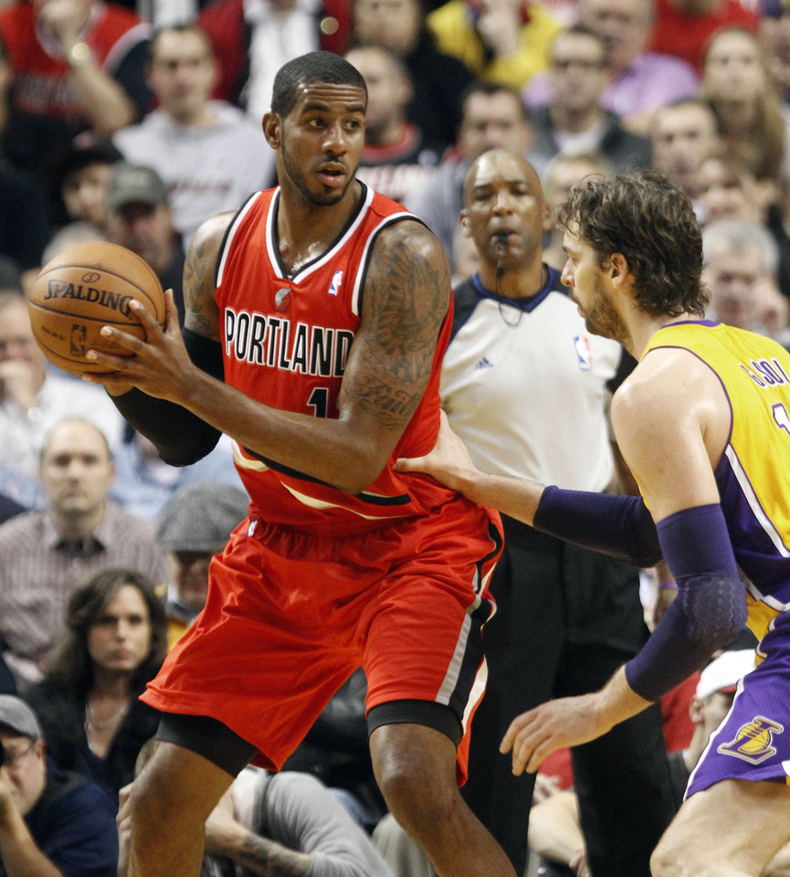 Photo -   Portland Trail Blazers forward LaMarcus Aldridge, left, looks to pass against Los Angeles Lakers forward Pau Gasol, from Spain, during the first quarter of an NBA basketball game in Portland, Ore., Wednesday, Oct. 31, 2012. (AP Photo/Don Ryan)