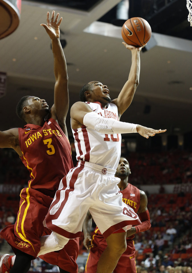 Oklahoma Sooner's Jordan Woodard (10) shoots guarded by Iowa State Cyclone's Melvin Ejim (3) as the University of Oklahoma Sooners (OU) men play the Iowa State Cyclones (ISU) in NCAA, college basketball at The Lloyd Noble Center on Saturday, Jan. 11, 2014  in Norman, Okla. Photo by Steve Sisney, The Oklahoman