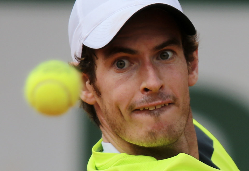Photo - Britain's Andy Murray eyes the ball as he plays  Kazakhstan's Andrey Golubev during the first round match of  the French Open tennis tournament at the Roland Garros stadium, in Paris, France, Tuesday, May 27, 2014. Murray won 6-1, 6-4, 3-6, 6-3. (AP Photo/David Vincent)