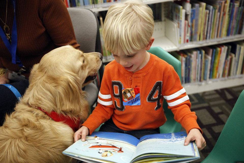 Reading to dogs is available at the Edmond library and most branches in the Metropolitan Library System. Photo by Sarah Phipps, The Oklahoman Archives