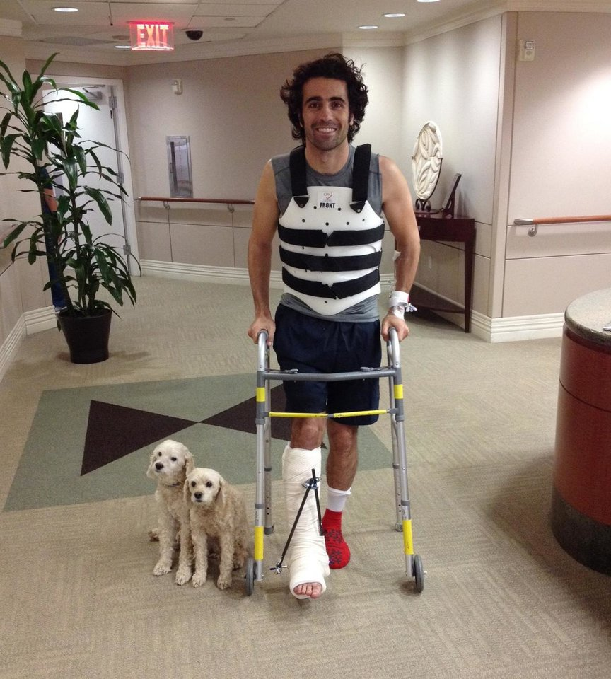Photo - In this photo provided by Team Chip Ganassi Racing, IndyCar driver Dario Franchitti, of Scotland, poses with his dogs, Shug and Buttermilk, in a photo taken by his brother, Marino Franchitti, at Memorial Hermann-Texas Medical Center in Houston, Thursday, Oct. 10, 2013. Franchitti has been released from a Houston hospital, four days after fracturing his spine and breaking his right ankle in an IndyCar Series crash. (AP Photo/Marino Franchitti)