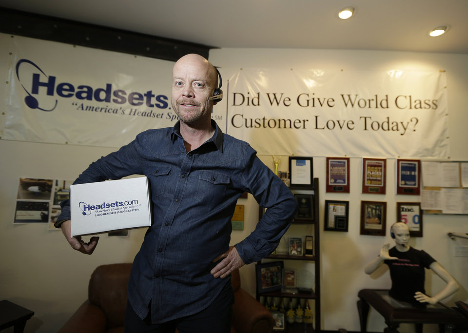 In this Tuesday, Jan. 15, 2013, photo, CEO and President Mike Faith of Headsets.com poses in his offices in San Francisco. Headsets.com, might have to hire two staffers to handle the administrative work if what's called remote tax collection becomes law, says Faith. The company has operations in California and Tennessee, but sells to all 50 states. Currently, federal law only requires the company to collect tax in those two states. (AP Photo/Eric Risberg)