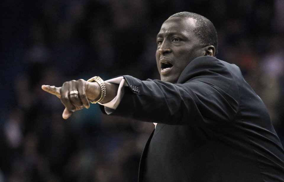 Photo - Utah Jazz head coach Tyrone Corbin calls to his team against the New Orleans Pelicans in the first half of an NBA basketball game in New Orleans, Friday, March 28, 2014. (AP Photo/Bill Haber)