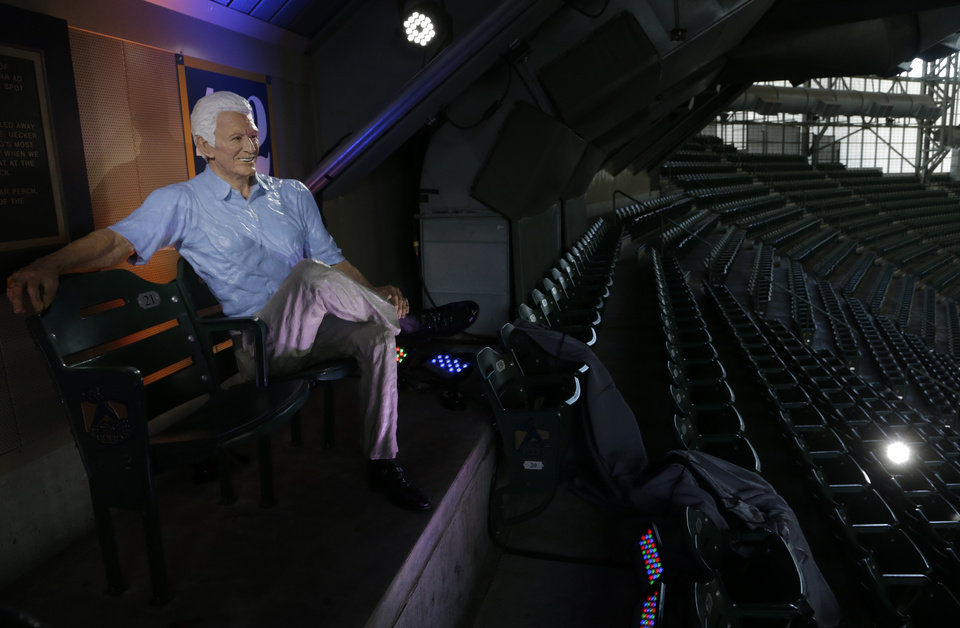 Photo - A statue of Milwaukee Brewers radio announcer Bob Uecker is seen Friday, April 25, 2014, at Miller Park in Milwaukee. The statue of the Hall of Fame broadcaster was unveiled before the Brewer's game against the Chicago Cubs. (AP Photo/Morry Gash)