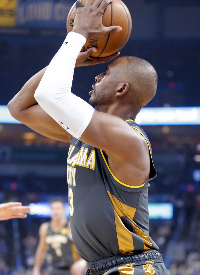 Photo - Oklahoma City's Chris Paul (3) shoots during the NBA basketball game between the Oklahoma City Thunder and the Denver Nuggets at the Chesapeake Energy Arena in Oklahoma City,  Friday, Feb. 21, 2020.  [Sarah Phipps/The Oklahoman]