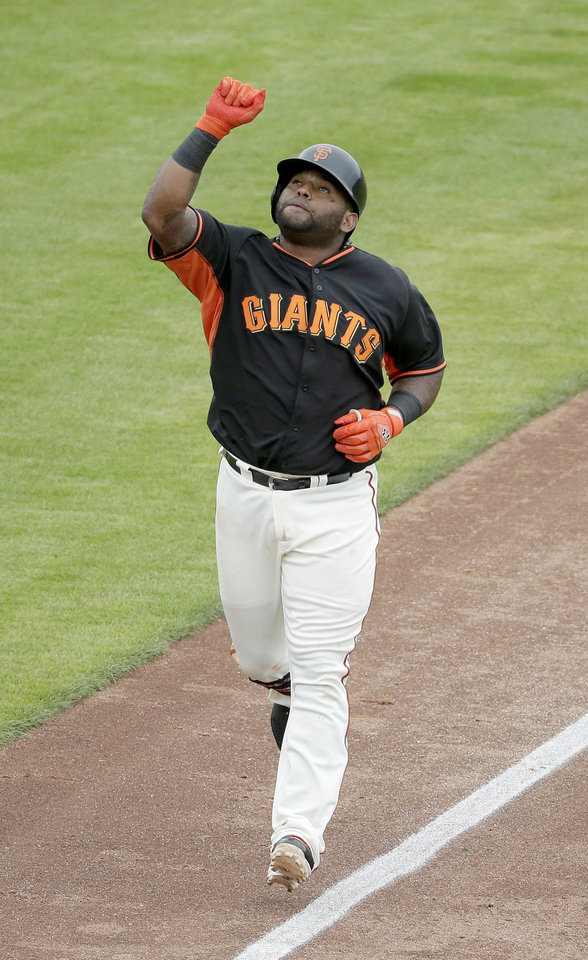 Photo - San Francisco Giants third baseman Pablo Sandoval celebrates a solo home run against the Cincinnati Reds during the fifth inning of a spring training baseball game in Scottsdale, Ariz., Thursday, March 6, 2014. (AP Photo/Chris Carlson)
