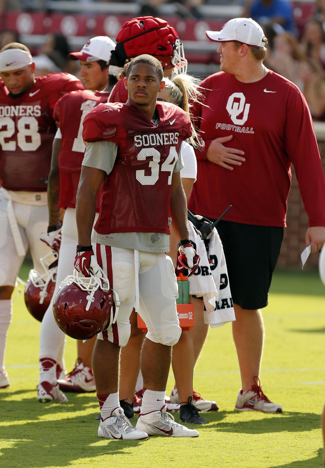 Photo - Oklahoma Sooners's Daniel Brooks (34) waits to play during the University of Oklahoma Sooners (OU) practice and Student Day at Gaylord Family-Oklahoma Memorial Stadium in Norman, Okla., on Thursday, Aug. 21, 2014. Photo by Steve Sisney, The Oklahoman