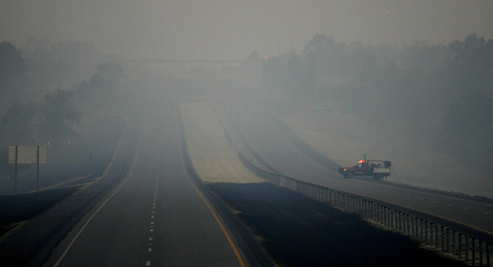 Photo - A fire vehicle is parked on a empty I-35 just north of Coffee Creek in Edmond, Okla., Saturday, August 6, 2011. Photo by Bryan Terry, The Oklahoman