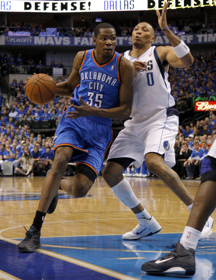 Photo - Oklahoma City's Kevin Durant (35) goes around Shawn Marion (0) of Dallas  during game 5 of the Western Conference Finals in the NBA basketball playoffs between the Dallas Mavericks and the Oklahoma City Thunder at American Airlines Center in Dallas, Wednesday, May 25, 2011. Photo by Bryan Terry, The Oklahoman
