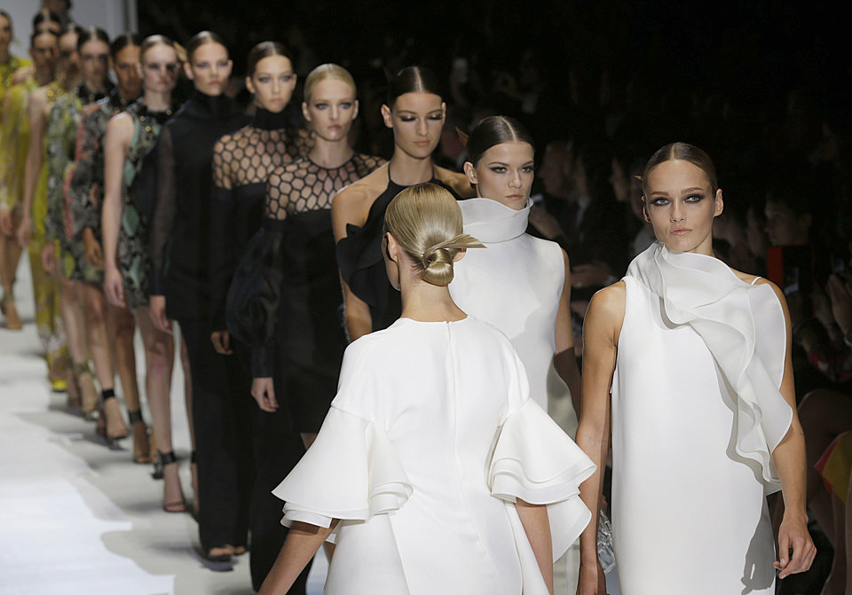 Photo -   Models wear creations part of the Gucci women's Spring-Summer 2013 collection that was presented in Milan, Italy, Wednesday, Sept.19, 2012. (AP Photo/Luca Bruno)