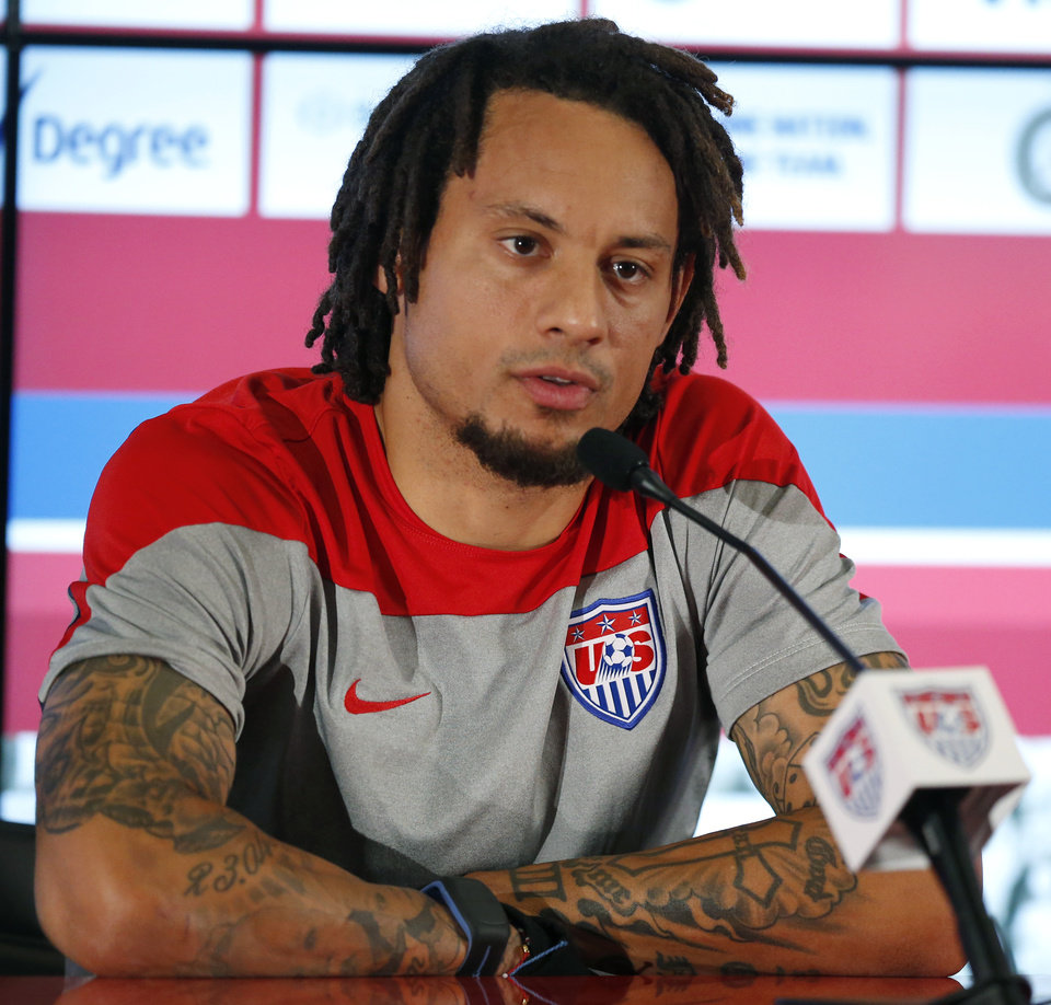 Photo - United States' Jermaine Jones talks during a press conference before a training session in Sao Paulo, Brazil, Thursday, June 19, 2014.  The United States will play against Portugal in group G of the 2014 soccer World Cup on June 22. (AP Photo/Julio Cortez)