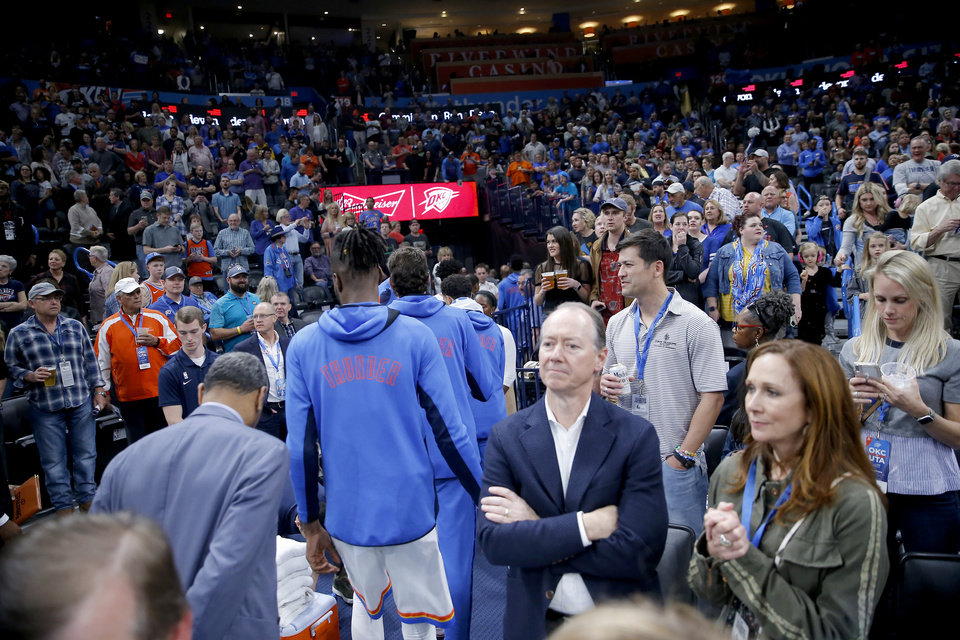 Photo - The Oklahoma City Thunder leave the court before an NBA basketball game between the Oklahoma City Thunder and the Utah Jazz was postponed at Chesapeake Energy Arena in Oklahoma City, Wednesday, March 11, 2020. [Bryan Terry/The Oklahoman]