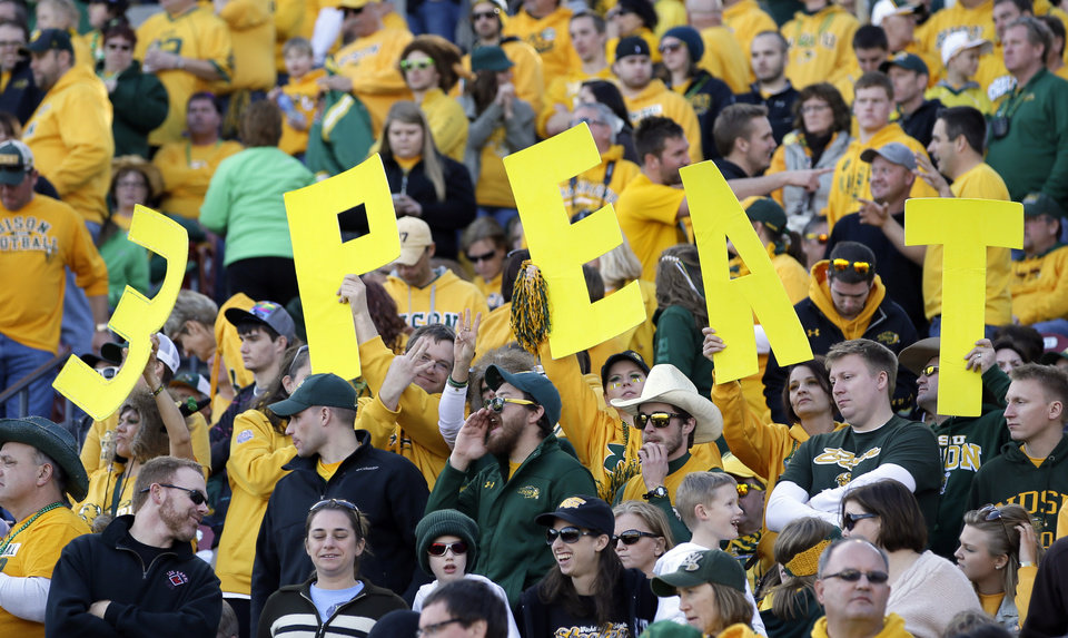Photo - North Dakota State fans hold up signs that read