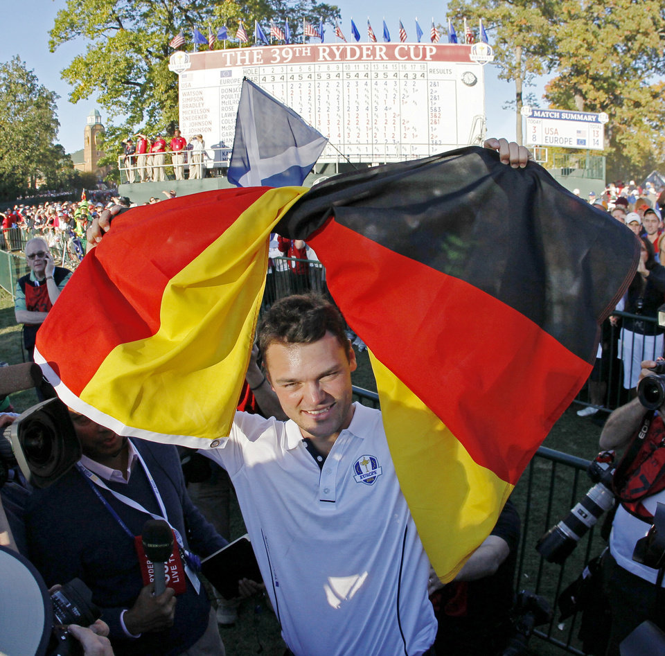 Photo - Europe's Martin Kaymer celebrates after winning the Ryder Cup PGA golf tournament Sunday, Sept. 30, 2012, at the Medinah Country Club in Medinah, Ill. (AP Photo/Charles Rex Arbogast)  ORG XMIT: PGA208