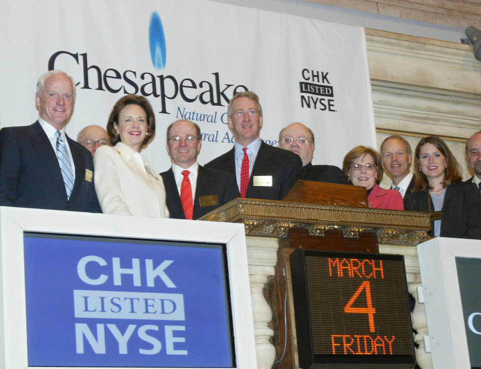 In this photo released by the New York Stock Exchange, New York Stock Exchange president and chief operating officer Catherine Kinney, second left, joins Chesapeake Energy Corporations president and chief operating officer Tom L. Ward, third left, Aubrey K. McClendon, chairman and chief executive officer, fourth left with other board members and their guests for the opening bell at the New York Stock Exchange, Friday, March 4, 2005. (AP Photo/NYSE, Mel Nudelman)