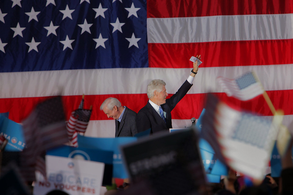 Former President Bill Clinton, right, arrives at a rally for Barack Obama at Pullen Park in Raleigh, N.C., Sunday, Nov. 4, 2012, after being introduced by former North Carolina Governor Jim Hunt, left. The former president has been traveling to several battleground states over the past week to try to stem any Republican tide for Mitt Romney and preserve Obama leads. (AP/Ted Richardson)