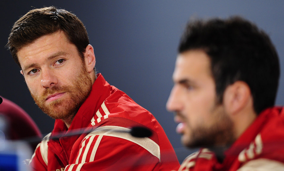 Photo - Spain's Xabi Alonso, left, and Cesc Fabregas attend a press conference at the Atletico Paranaense training center in Curitiba, Brazil, Sunday, June 15, 2014. Spain will play in group B of the Brazil 2014 World Cup. (AP Photo/Manu Fernandez)