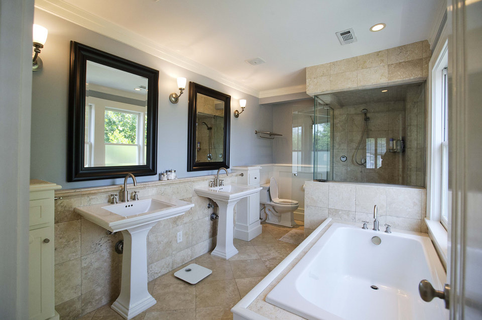 Photo - A pair of matching sinks highlight the master bathroom of this three bedroom house listed for sale at $1,095,000, Wednesday, July 30, 2014, in the Sherwood Forest neighborhood of Atlanta. The 2,551-square-foot house has two and a half bathrooms and features an in-ground pool and garage. (AP Photo/David Goldman)