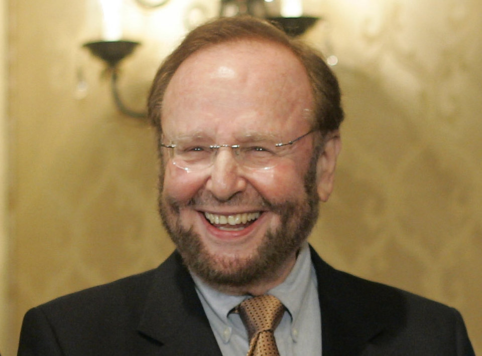 Photo - FILE - In this May 25, 2005 file photo, Tampa Bay Buccaneers team owner and president Malcolm Glazer smiles at the announcement of Tampa Bay being awarded the 2009 Super Bowl, during the NFL's Spring Meetings at the Ritz-Carlton Hotel in Washington. Glazer, the self-made billionaire who owned the NFL's Tampa Bay Buccaneers and English soccer's Manchester United, has died.  He was 85. The Bucs said Glazer died Wednesday, May 28, 2014.  (AP Photo/J. Scott Applewhite, File)