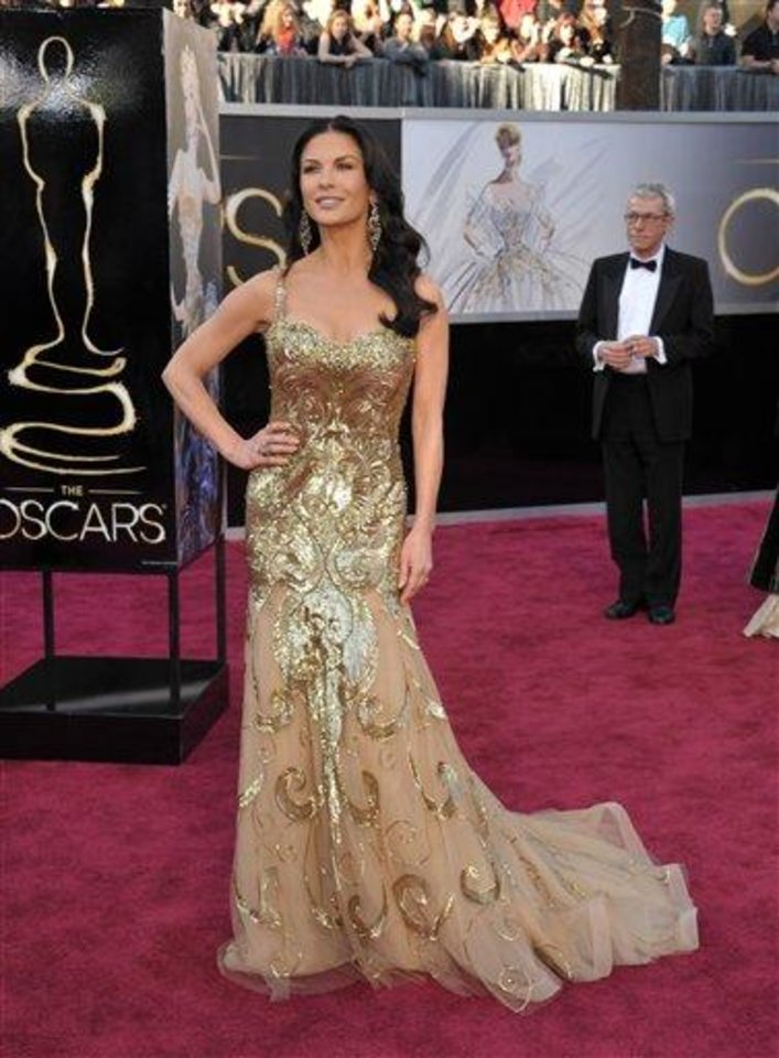 Photo - Actress Catherine Zeta-Jones arrives at the Oscars at the Dolby Theatre on Sunday Feb. 24, 2013, in Los Angeles. (Photo by John Shearer/Invision/AP)