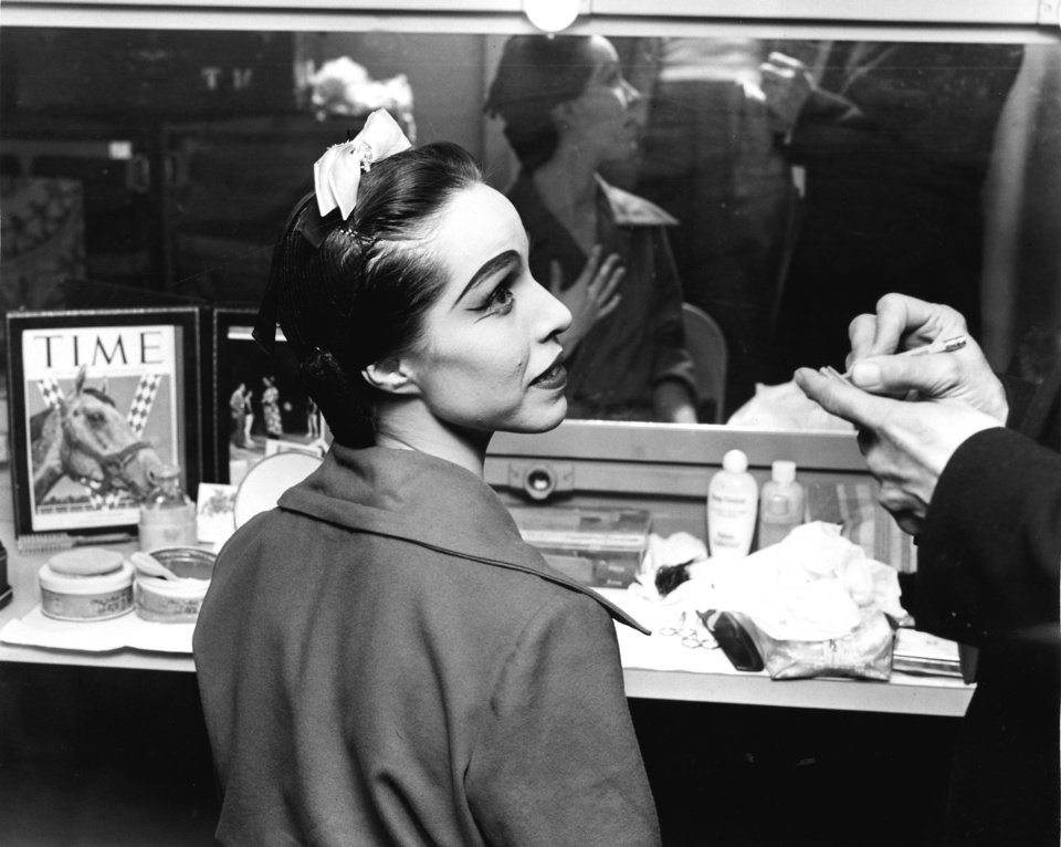 "BALLERINAS: Oklahoma Indian ballerina Maria Tallchief  is interviewed prior to her performance with premier danseur Frederic Franklin in Tulsa Wednesday night as the duo prepares for their ""Swan Lake"" performance. Staff photo by Bob Albright taken 12/15/54."