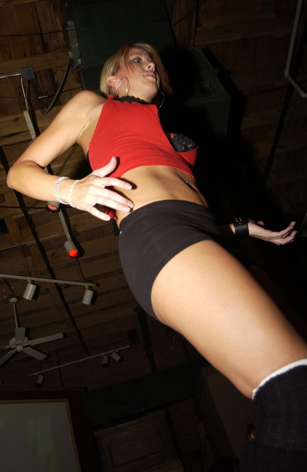 "Photo - GoGo dancers at the club Citywalk in Bricktown work up a sweat and provide plenty of ""eye candy"" for the crowd."