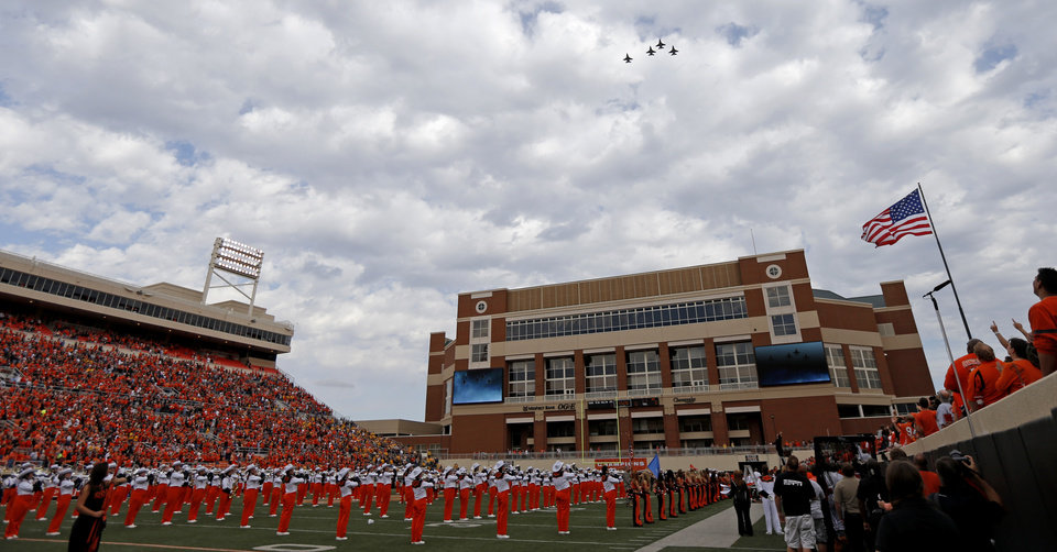 Photo - F-16's fly over before a college football game between Oklahoma State University (OSU) and West Virginia University at Boone Pickens Stadium in Stillwater, Okla., Saturday, Nov. 10, 2012. Oklahoma State won 55-34. Photo by Bryan Terry, The Oklahoman