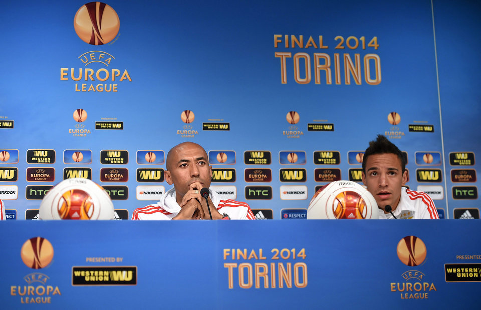Photo - In this photo made available by Uefa, Benfica captain Luisao, left, and his teammate Rodrigo listens during a press conference ahead of tomorrow's final of the Europa League against Sevilla, at the Juventus stadium in Turin, Italy, Tuesday, May 13, 2014 ( AP Photo/Uefa, HO)