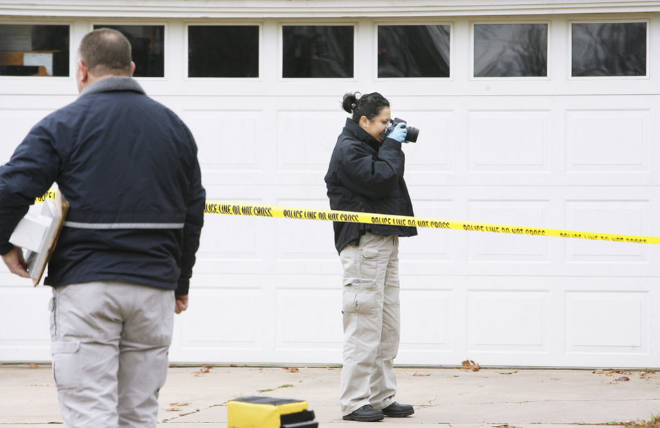 Photo - Left: Oklahoma State Bureau of Investigation agents investigate a slaying Monday at 1715 Elmhurst Ave. in Nichols Hills. PHOTO BY PAUL B. SOUTHERLAND, THE OKLAHOMAN