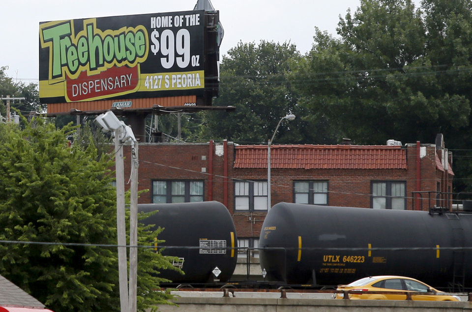 Photo -  This advertisement for Treehouse Dispensary can be seen by drivers on the Broken Arrow Expressway. [JOHN CLANTON/TULSA WORLD]