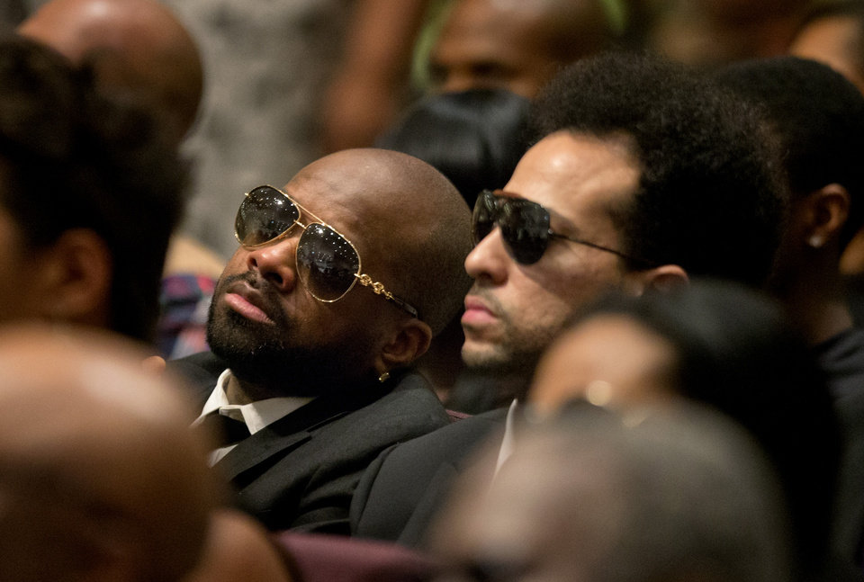 Rapper-producer Jermaine Dupri, left, and Chris Smith, surviving member of the rap duo Kris Kross, attend the funeral service of Chris Kelly, Thursday, May 9, 2013, in Atlanta. The 34-year-old Kelly was found dead May 1 of a suspected drug overdose.  Kriss Kross was introduced to the music world in 1992 by music producer and rapper Jermaine Dupri after he discovered the pair at a mall in southwest Atlanta. (AP Photo/David Goldman)