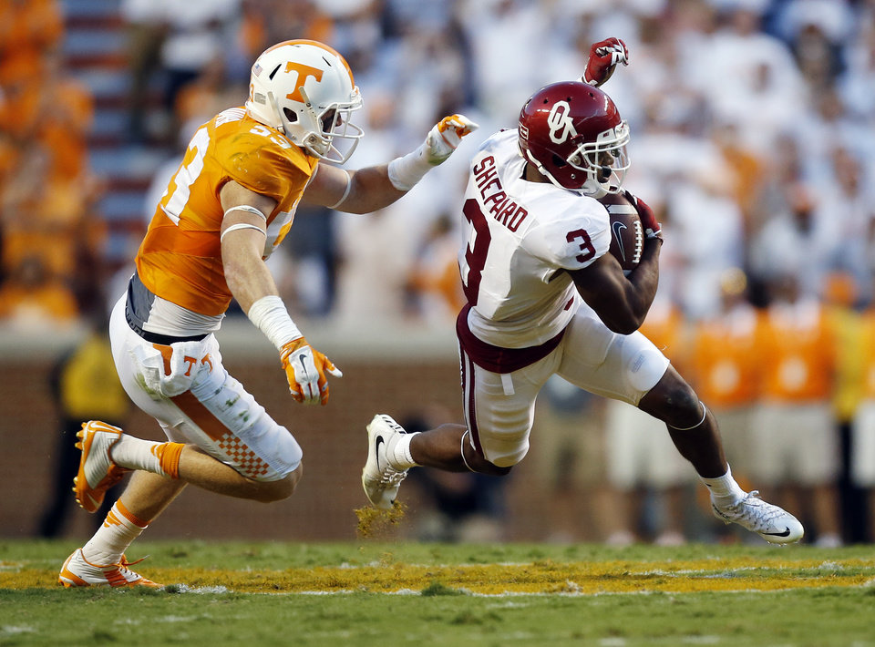 Photo - Oklahoma's Sterling Shepard (3) runs after a catch away from Tennessee's Colton Jumper (53) during the college football game between the Oklahoma Sooners (OU) and the Tennessee Volunteers at Neyland Stadium in Knoxville, Tennessee, Saturday, Sept. 12, 2015. Photo by Nate Billings, The Oklahoman