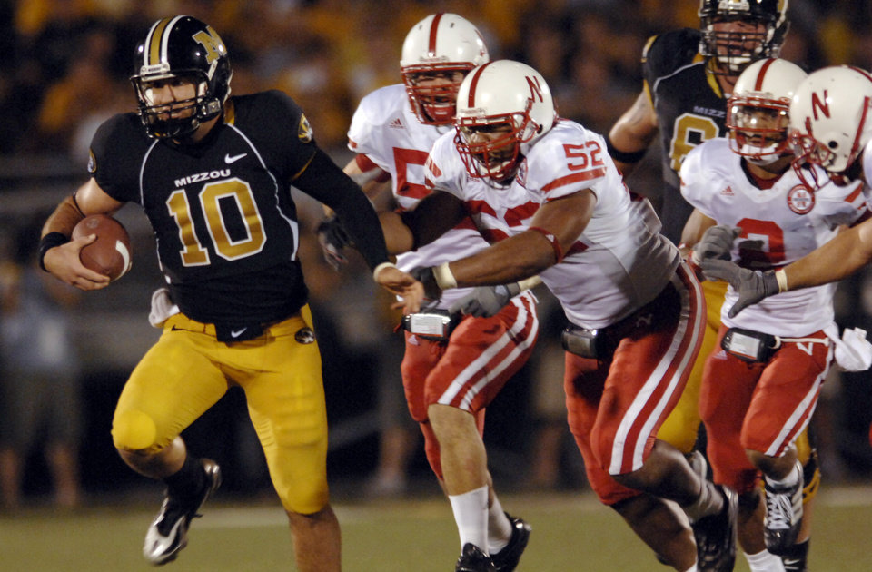 Photo - University of Missouri quarterback Chase Daniel (10) runs for a long gain as members of the Nebraska defense, including Phillip Dillard (52), give chase during the second quarter of a college football game Saturday, Oct. 6, 2007, in Columbia, Mo. (AP Photo/L.G. Patterson) ORG XMIT: MOJR114