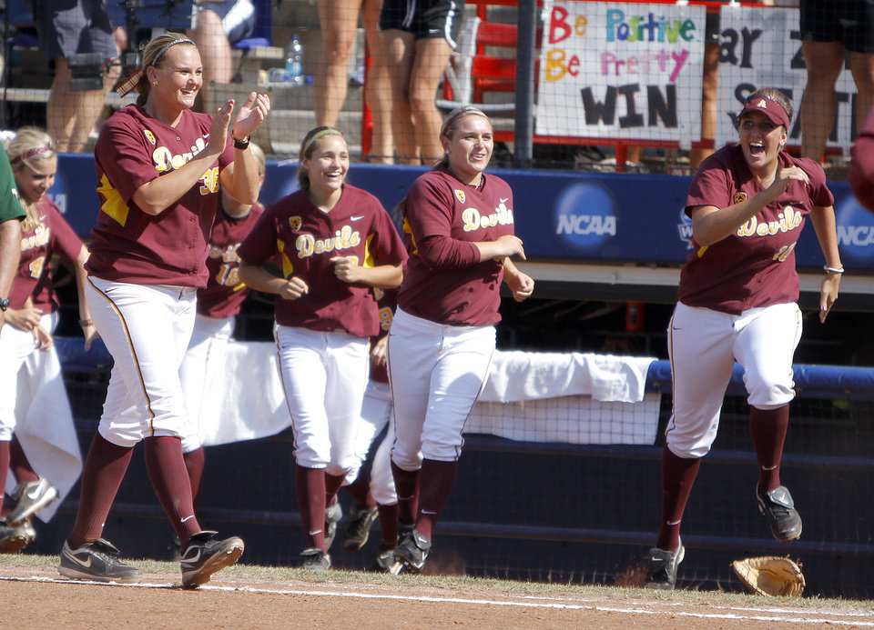 Photo - Arizona State celebrates their win over Baylor during the Women's College World Series game between Arizona State and Baylor at the ASA Hall of Fame Stadium in Oklahoma City, Sunday, June 5, 2011. Photo by Sarah Phipps, The Oklahoman