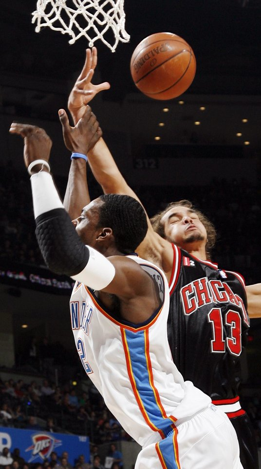Chicago's Joakim Noah (13) knocks the ball away from Oklahoma City's Jeff Green (22) in the first half of the NBA basketball game between the Chicago Bulls and the Oklahoma City Thunder at the Ford Center in Oklahoma City, Wednesday, March 18, 2009. PHOTO BY NATE BILLINGS, THE OKLAHOMAN