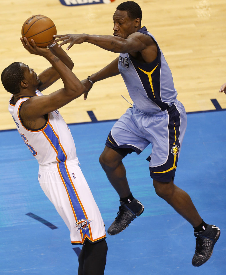 Photo - Oklahoma City's Kevin Durant (35) shoots over Memphis' Tony Allen (9) during Game 5 in the first round of the NBA playoffs between the Oklahoma City Thunder and the Memphis Grizzlies at Chesapeake Energy Arena in Oklahoma City, Tuesday, April 29, 2014. Photo by Nate Billings, The Oklahoman