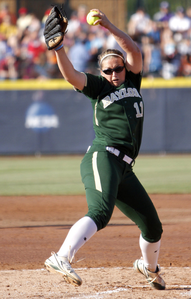 Photo - Baylor's Whitney Canion (11) pitches during the Women's College World Series game between Baylor and Alabama at the ASA Hall of Fame Stadium in Oklahoma City, Friday, June 3, 2011. Photo by Sarah Phipps, The Oklahoman ORG XMIT: KOD
