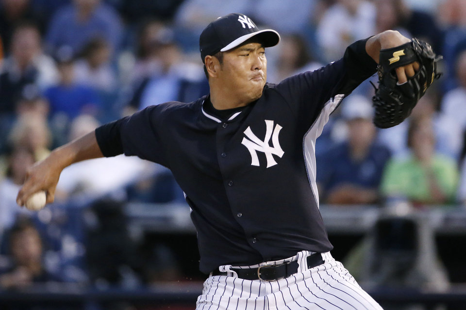 Photo - New York Yankees starting pitcher Hiroki Kuroda delivers in the second inning of a spring exhibition baseball game against the Miami Marlins in Tampa, Fla., Friday, March 28, 2014. (AP Photo/Kathy Willens)