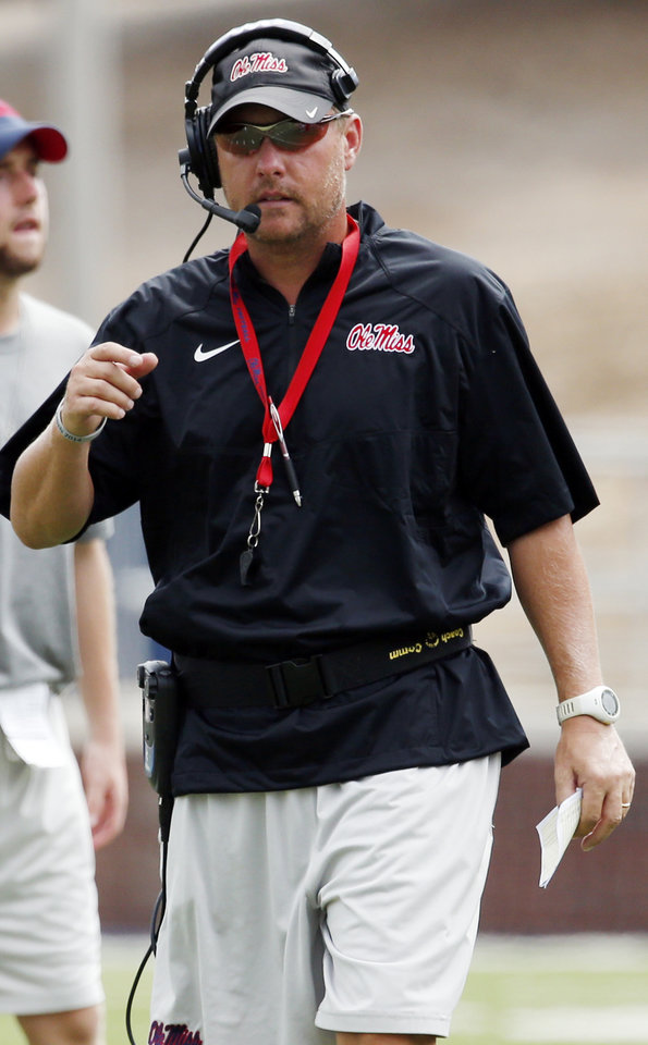 Photo - Mississippi football coach Hugh Freeze walks along the sideline during their final open NCAA college football practice, Saturday, Aug. 9, 2014, at Mississippi, in Oxford Miss. Players were involved in individual and team drills. (AP Photo/Rogelio V. Solis)