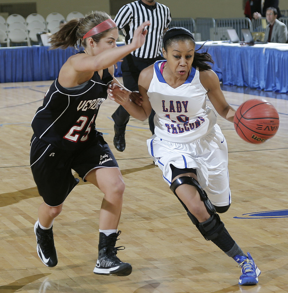 Photo - Millwood's Teanna Reid (10) drives past Verdigris' Baileigh O'Dell (25) during the 3A girls quarterfinals game between Millwood High School and Verdigris High School at the State Fair Arena on Thursday, March 7, 2013, in Oklahoma City, Okla. Photo by Chris Landsberger, The Oklahoman