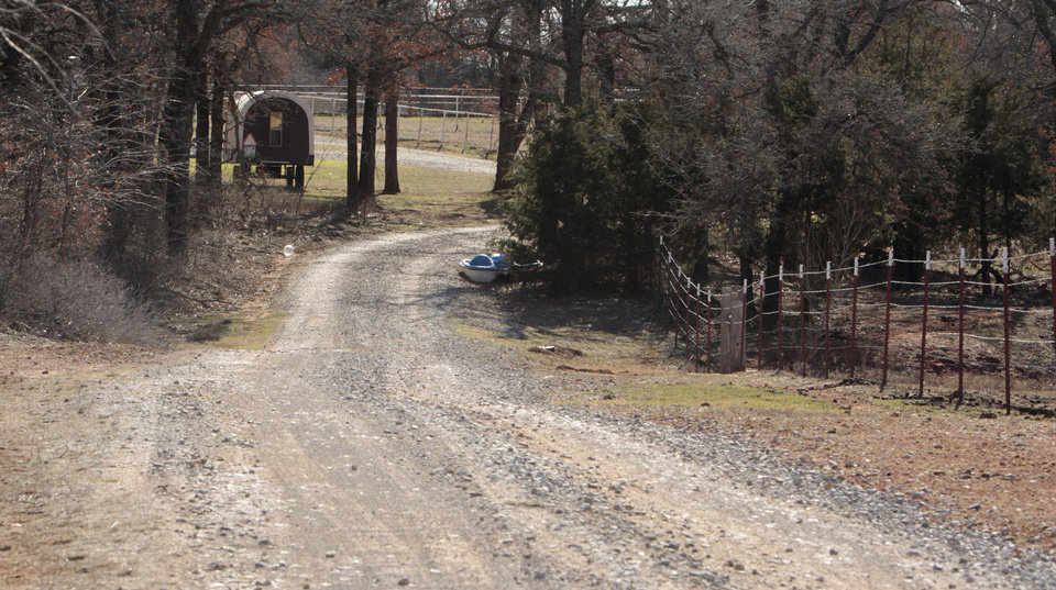 Photo - A long gravel drive leads to the home of Sarah McKinley, 18, and her son Justin, on Wednesday, Jan. 4, 2012, in Blanchard, Okla.  McKinley shot and killed an intruder who broke through the front door.  Photo by Steve Sisney, The Oklahoman ORG XMIT: KOD