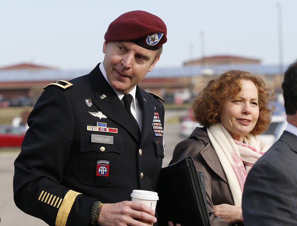 Photo - Brig. Gen. Jeffrey Sinclair, left, who admitted to inappropriate relationships with three subordinates, arrives at the courthouse with attorney Ellen Brotman, right, for sentencing at Fort Bragg, N.C., Thursday, March 20, 2014.  Sinclair was reprimanded and docked $20,000 in pay Thursday, avoiding jail time in one of the U.S. military's most closely watched courts-martial.(AP Photo/Ellen Ozier)