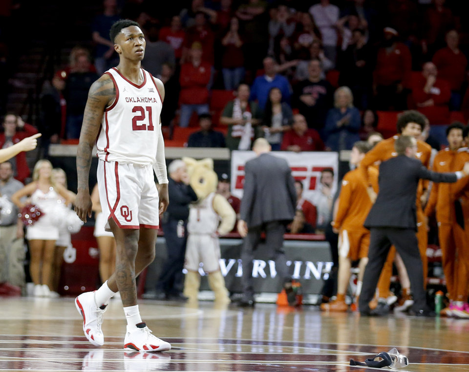 Photo - Oklahoma's Kristian Doolittle (21) walks off the court for a timeout after Texas made a go-ahead 3-point basket during an NCAA college basketball game in Norman, Okla., Tuesday, March 3, 2020. (Sarah Phipps/The Oklahoman via AP)