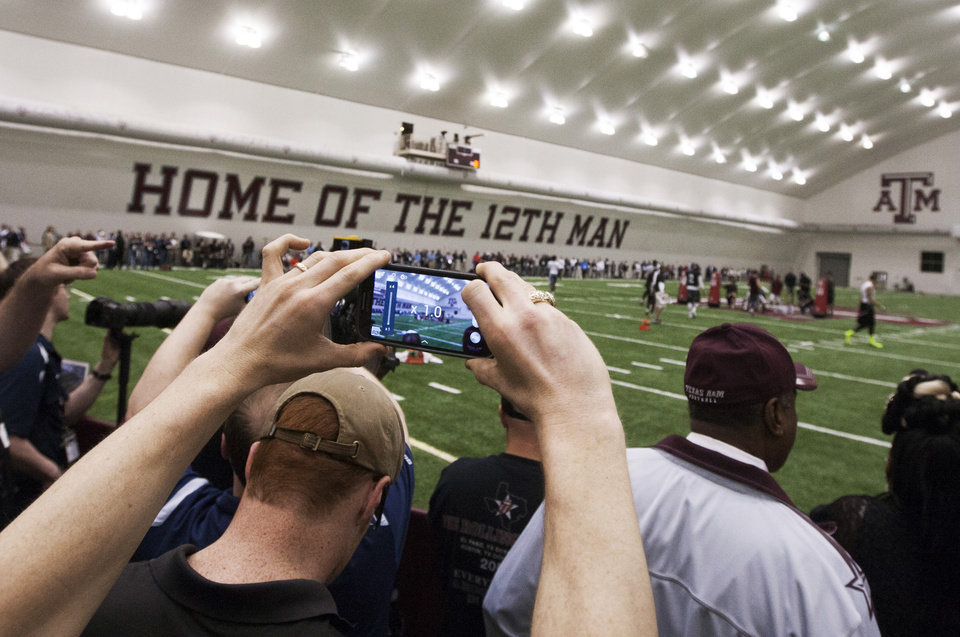 Media and NFL football representatives attend Texas A&M\'s pro day at the McFerrin Athletic Center in College Station, Texas, Thursday, March 27, 2014. (AP Photo/Patric Schneider)