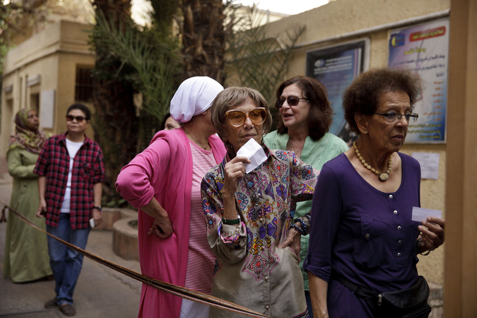 Photo - Egyptian women wait to vote at a polling site in an election that comes nearly a year after the military's ouster of the nation's first freely elected president, the Islamist Mohammed Morsi in Cairo, Egypt, Monday, May 26, 2014. The man who removed Morsi, retired military chief Field Marshal Abdel-Fattah el-Sissi, is practically assured of a victory in the vote. (AP Photo/Maya Alleruzzo)